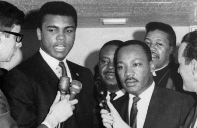 Dr. Martin Luther King Jr. and Muhammad Ali speak with reporters in Louisville. (AP Photo)